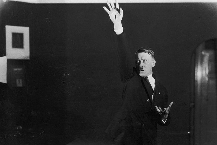 Hitler posing to a recording of one of his speeches after his release from Landsberg Prison. (Photo by Heinrich Hoffmann/Getty Images)